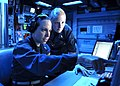 U.S. Navy Lt. j.g. Theresa Rouse, left, a training officer, and Ensign Stephanie Wexler, a combat information center officer, review contacts at the anti-air warfare coordinator watch station in the combat 130527-N-KB052-280.jpg