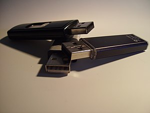 3 USB Flash Drives stacked.