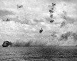 USS Yorktown (CV-5) burning and listing on 4 June 1942.jpg