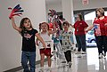 US Army 51073 Cynthia Potvin, principal of Venable Village Elementary school, walks with her students during the school's Freedom Walk on Sept. 11. The walk was a chance for the students to show pride in their coun.jpg