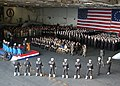 US Navy 021109-N-6433N-001 Sailors aboard the Washington attend a memorial service held in the ship's hangar bay for Lieutenant Commander Robert Clukey III.jpg