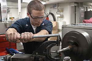 Machinist - Machinery repairman creates helicopter part aboard aircraft carrier