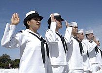 US Navy 030501-N-9214D-048 Sailors raise their right hands and take the oath of U.S. citizenship during a naturalization ceremony held at Cabrillo National Monument.jpg