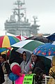 US Navy 030523-N-3642E-006 Family and friends wait in the pouring rain for Sailors and Marines assigned to USS Harry S. Truman (CVN 75) to return from a six-month deployment.jpg