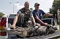 US Navy 030530-N-5862D-219 Chief Aviation Boatswain's Mate Rodger Wisdom and volunteers from the Navy fire department wrangle a ten-foot alligator aboard Naval Submarine Base King's Bay, Ga.jpg