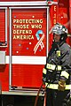 US Navy 030718-N-0106C-001 A member of the Oahu Federal Fire Department stands by one of the departments newest fire trucks during Federal Fire Department Day.jpg