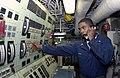 US Navy 030816-N-2613R-003 A Gas Turbine System Technician checks a hi-temperature alarm indicator on an alpha gas turbine generator.jpg