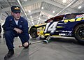 US Navy 040130-N-5576W-003 Recruit Division Commander (RDC) Hull Maintenance Technician 1st Class Duane Dominick practices being the jackman prior to the pit stop competition.jpg