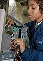 US Navy 040325-N-1512S-019 Information Systems Technician 2nd Class Quemeka Hill conducts maintenance on a Central Processing Unit (CPU) in Computer Repair aboard the amphibious assault ship USS Kearsarge (LHD 3).jpg