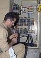 US Navy 050117-N-6736W-119 Senior Chief Jose Gomez of Sterling, Ill., assigned to USS Abraham Lincoln (CVN 72), repairs a generator that will provide power to Indonesian Government offices.jpg