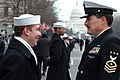 US Navy 050120-N-0962S-040 Master Chief Petty Officer of the Navy (MCPON) Terry Scott visits with one of the hundreds of Sailors who helped line the street cordon down Pennsylvania Avenue for the Inauguration Day Parade.jpg