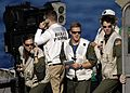 US Navy 050221-N-1229B-023 Landing Signal Officers (LSO) monitor the flight deck from the LSO Platform as an aircraft lands aboard the Nimitz-class aircraft carrier USS Abraham Lincoln (CVN 72).jpg