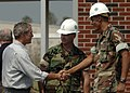 US Navy 050912-N-6925C-002 President George W. Bush conveys his gratitude to U.S. Navy Chief Builder Dan Walker his Seabees are accomplishing during the clean up of 28 Street Elementary School in Gulfport, Miss.jpg