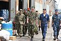US Navy 050916-N-0000X-001 Commander Second Fleet, Vice Adm. Mark Fitzgerald along with several other Sailors and Marines walk through the hurricane devastated city of New Orleans.jpg