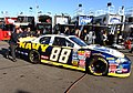 US Navy 060215-N-5862D-108 Members of JR Motorsports push the No. 88 Navy Chevrolet Monte Carlo to pit row before practice at the Daytona International Speedway.jpg