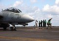 US Navy 060227-N-7241L-036 An Aviation Boatswain's Mate clears from the catapult before the launch of an F-14D Tomcat.jpg