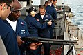 US Navy 060321-N-7130B-004 Sailors are instructed in the proper handling and use of a 12-guage shotgun during a familiarization firing exercise on the fantail of the Nimitz-class aircraft carrier USS Ronald Reagan (CVN 76).jpg