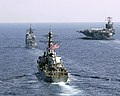 US Navy 060416-N-5837R-027 USS Mobile Bay (CG 53), USS Russell (DDG 59), and USS Shoup (DDG 86) perform a pass and review with the Nimitz-class aircraft carrier USS Abraham Lincoln (CVN 72).jpg