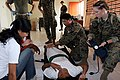 US Navy 060602-M-1837P-010 Sailors with the 3rd Marine Expeditionary Force's Indonesia medical relief team examines an Indonesian for lacerations and broken bones at a mobile surgical hospital in Sewon, Indonesia.jpg