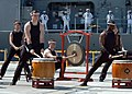 US Navy 060829-N-1332Y-067 Sailors assigned to the guided-missile cruiser USS Chancellorsville (CG 62) perform taiko, Japanese for great drum, during a welcoming ceremony.jpg