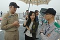 US Navy 060901-N-1332Y-366 The frigate Public Affairs Officer for the U.S. Navy frigate USS Gary (FFG 51), Lt. j.g. Kellie Young speaks with a Japanese government employee participating in a Tokyo Metropolitan Government Disast.jpg