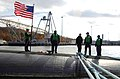 US Navy 061107-N-8467N-001 Crew members assigned to the Los Angeles-class attack submarine USS Toledo (SSN 769) prepares to get underway from Subase New London.jpg