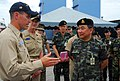 US Navy 070516-N-4124C-053 Lt. Cmdr. Steven H. DeMoss, commanding officer, USS Guardian (MCM 5), explains the capabilities of the mine warfare ship to Royal Thai Army Gen. Kemarat Kanchanawat, Royal Thai Armed Forces Deputy Chi.jpg