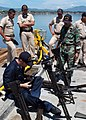 US Navy 070731-N-4021H-067 Gunner's Mate 2nd Class Nicholas Silicz stationed aboard the dock landing ship USS Pearl Harbor (LSD 52) performs routine maintenance on various firearms with members of the Salvadorian Navy.jpg