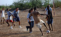 US Navy 070827-N-1003P-081 Sailors going through chief petty officer transition and other chief petty officers enjoy a game of soccer at a boys orphanage.jpg