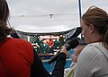 US Navy 071106-N-5411L-071 The wife of a Sailor aboard amphibious assault ship USS Bonhomme Richard (LHD 6) speaks to her husband and shows of their new daughter during a live satellite feed into Shamu Stadium at Sea World.jpg