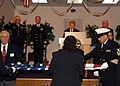 US Navy 071110-N-9860Y-004 Chief Builder Marc deLeuze and members of the Oak Harbor Elks Lodge perform a ceremonial flag folding at the Oak Harbor Veterans Day ceremony.jpg