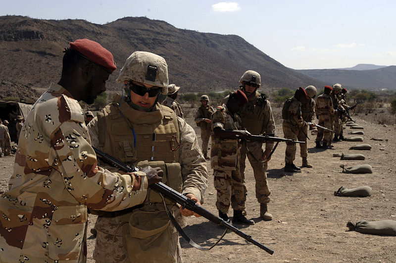 File:US Navy 071210-F-0509T-006 Hospitalman 3rd Class Jeremy Jordon instructs a member from the Djiboutian Army on the PK-M (Djiboutian firearm) at Arta Range TC-13.jpg