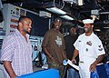 US Navy 080203-N-5476H-021 Operations Specialist 2nd Class Chancer Burton enjoys a joke with Lorenzo Neal, left, fullback for the San Diego Chargers, during a tour of the Ticonderoga-class guided-missile cruiser USS Chosin (CG.jpg