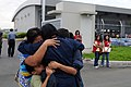 US Navy 080627-N-3659B-018 Storekeeper Seaman Grace Geroche, a native of Iloilo and Sailor assigned to the Nimitz-class aircraft carrier USS Ronald Reagan (CVN 76), embraces family members.jpg