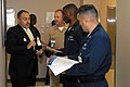 US Navy 080813-N-9493W-033 Joe Oliver, assistant director of admissions at DeVry University in Westminster, Colo., speaks with Sailors about the variety of degree programs at DeVry.jpg