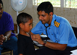 US Navy 080821-N-6387D-085 Indian Navy Surgeon Cmdr. Ranjeet Thergaonkar listens to the heart of Pohnpein patient during a medical civic action program (MEDCAP) at Sapwalap Elementary School in Pohnpei.jpg