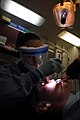 US Navy 081011-N-9610C-007 ospital Corpsman Dami-anne Boykin gives Aviation Electronics Technician 3rd Class Michael Morgan his yearly tooth cleaning.jpg