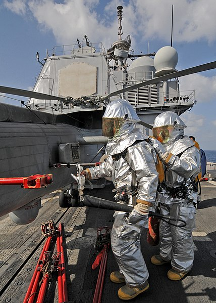 File:US Navy 090206-N-1082Z-025 Boatswain's Mate 3rd Class Khristophor Villar, from Oklahoma City, and Seaman Kendall A. Reep, from Hickory, N.C., participate in a flight deck fire drill.jpg