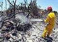 US Navy 090711-N-0780F-004 Naval Support Activity, Souda Bay civilian firefighters mop up the remnants of a brush fire near the village of Pazinos in western Crete.jpg