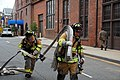 US Navy 090723-N-8732C-001 Naval Support Activity Washington (NSAW) firefighters pull hose as a precaution at the early morning Hazardous Materials (HAZMAT) incident at the Washington Navy Yard.jpg