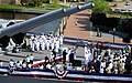 US Navy 100416-N-3154P-033 Guests salute the national ensign aboard the decommissioned Iowa-class battleship USS Wisconsin (BB-64).jpg