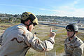 US Navy 110128-N-2943C-150 Aircrew Survival Equipmentman 2nd Class Joshua Lovins instructs a student before he rappels during Explosive Ordnance Di.jpg