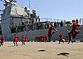 US Navy 110609-N-YM590-106 Children dance during a welcoming ceremony for the guided-missile cruiser USS Anzio (CG 68) as the ship arrives for a po.jpg