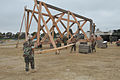 US Navy 110615-N-IL826-194 Seabees perform construction work on a 30 foot observation tower at the Construction Battalion Center training facility.jpg