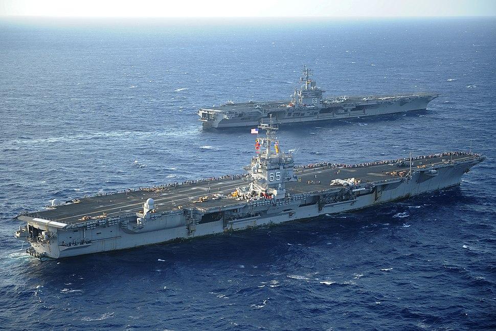 US Navy 110714-N-YC446-145 The aircraft carriers USS Enterprise (CVN 65) and USS Dwight D. Eisenhower (CVN 69) pass as Enterprise returns to homepo