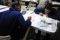 US Navy 110915-N-RC734-063 Culinary Specialist Seaman Angelena Moon, left, and Quartermaster Seaman Denise Perez take the E-4 advancement examinati.jpg