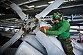 US Navy 120112-N-BT887-113 Aviation Machinist's Mate 3rd Class Felix Gonzales, from Gonzalez, Texas, cleans the tail rotor of an MH-60R Sea Hawk he.jpg