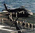US soldiers board UH-60 on USS Eisenhower (CVN-69) off Haiti in 1994.jpg