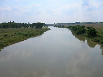 Vaal River - The Vaal River seen from the N3 national freeway, upstream from the Vaal Dam. Here it forms the border between the Mpumalanga and Free State provinces.