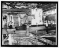 View of scanner building no. 104 showing emplacement process for one-half of upper radar switch housing body. RCA Services Company 6 September, 1960, official photograph BMEWS Project HAER AK-30-A-90.tif